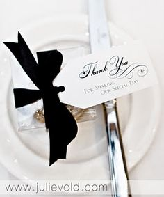 "Simple and chic Black + White ""Thank You"" note  at wedding reception dinner for guests. #blackandwhite"