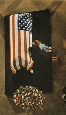 First Lady Mrs ~~Jacqueline and Caroline Kennedy kissing John F. Kennedy's coffin at his funeral (JFK casket in Capitol rotunda,