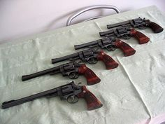 """Smith & Wesson .44 Mag collection. From right to left. Model 44 Magnum Premodel 29 6"""" 1/2 Model 29-2 4"""" Model 29-2 6"""" Model 29-2 6"""" 1/2 Model 29-2 8"""" 3/8 Model 29-3 10"""" 5/8 """"Silhouette"""""""