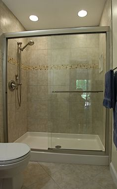Full size shower and small border detail with large tile...love it and will do something similar in my bathroom soon!!!