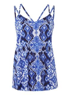 Add a touch of colour to your holiday wardrobe with this ikat patterned vest. Designed with slender straps and a scoop neckline, this piece will partner perfectly with denim shorts. Multicoloured irate pattern strappy vest Ikat pattern Slender straps Scoop neckline Model's height is 5'11
