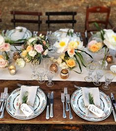 Pretty tablescape, i would rather use a lace runner in the middle of the table and i do not want yellow (maybe only a tiny touch of very light yellow) but I LOVE the rosemary accent on the plate (let's do ours with alternating rosemary sprigs and olive leaves - add to mix and match feel).  Also really like the plates and glasses with gold and little votive candles and the flowers directly on the table!