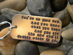 "Dr Seuss Keychain: You're On Your Own..Oh the places you'll go...I love Dr. Seuss. He was pure genius. This would make a great gift for someone who has recently graduated or left home for the first time...sniff sniff. I hand stamped it with a line from Dr. Seuss' popular book ""Oh the places you'll go"". It says ""You're on your own. And you know what you know. And YOU are the one who'll decide where to go""."