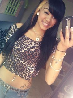 Leopard shirt , jewelry, hair, leopard print tattoo, lip piercing, nose piercing