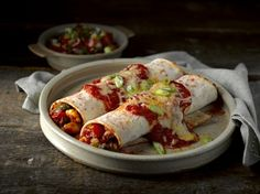 Topped with cheese and bursting with peppers, onion, sweetcorn and courgette, vegetable chilli enchiladas are a classic Mexican treat.