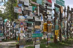 Signpost Forest, Watson Lake, Yukon.  See if you can spot a motorcycle, route 66, and a deer in this photo.  06/2013.
