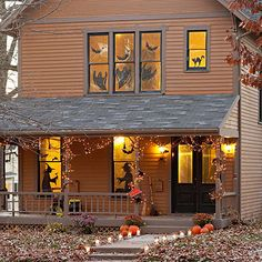 Creepy porch, idea from BHG.com.  lighted grapevine, bats, spiders, brooms, silhouettes of heavy paper, yellow cellophane, and luminaria along path or walkway...