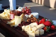 A fruit and cheese platter to pair with a bottle of wine.