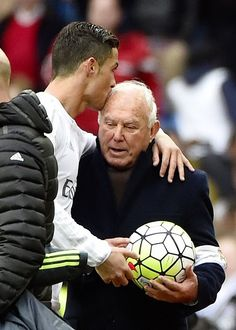 ..._Cristiano kisses Real Madrid's field delegate Agustín Herrerín as he gives him the match ball.