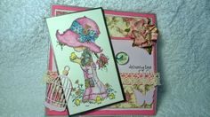 This card is made by colouring the Sarah Kay image with Inktense Pencils.