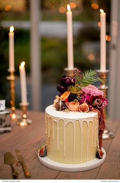 This one-tier wedding cake was festooned with an awe-inspiring topping of luscious fruits and blooms in vivid colours. | Photographer: Samantha Clifton | Confectioner: Lion Heart | Décor Supplier:Goeters
