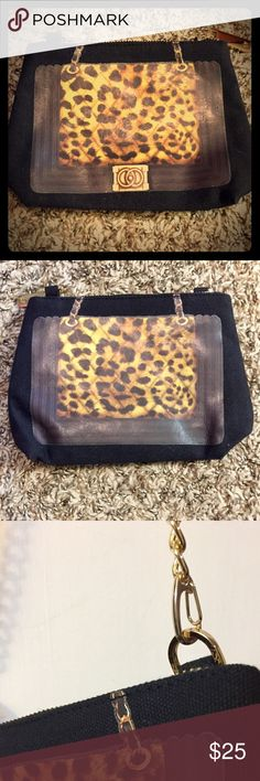 Black Canvas Leopard Clutch/Gold chain link purse Thursday Friday- Black Canvas with Leopard Print Clutch or Attach Gold Chain to wear as shoulder bag. This carry-everywhere travel clutch will help you simplify any day on the go. Its removable chain strap and roomy interior makes it suitable for a chic cosmetic case or to carry all the necessities for a night out. It's ideal for keeping small valuables organized for a weekend away. Brand new, never used. Thursday Friday Bags
