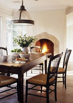 table in front of fireplace