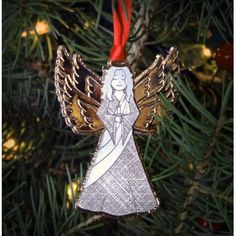 The Serenity Angel is the first in a series of annual collector ornaments. Handmade Christmas, Christmas Ornaments, Golden Wings, Serenity, Artisan, Angel, Holiday Decor, Handmade Gifts, Crafts