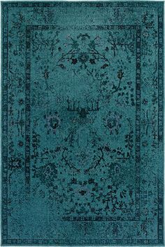 Electrify your space with this dazzling rug. The slightly faded design is reminiscent of an old, antique rug.