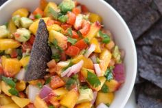 Avocado Peach Salsa.  GREAT over grilled tuna, halibut or chicken.  Think would be awesome over any white meat.