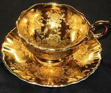 OLD FOLEY GOLDEN ROSE ETCH GOLD WIDE FOOTED TEA CUP AND SAUCER