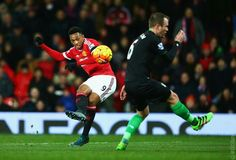 Anthony Martial bends it into the back of the net for 2-0 score against Stoke before the half.