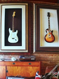 good display idea for guitars large frame with no glass i like the different