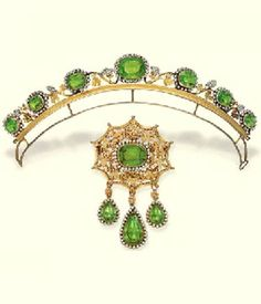 AN ANTIQUE PERIDOT AND SEED PEARL DEMI-PARURE, CIRCA 1830. The tiara designed as a graduated line of cushion-shaped peridot and pearl clusters to the pearl berries with gold filigrée vines and leaves, brooch en suite with three detachable pear-shaped drops, mounted in gold. #antique #tiara #brooch