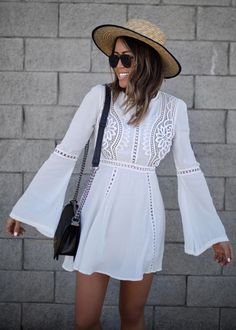 It may be fall but there's nothing wrong with stepping out in a sleek, winter white ensemble with festive flared sleeves a flirty hemline! Crochet Diary White Dress with Bell Sleeves featured by GypsyTan Blog