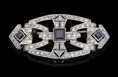 An art deco sapphire and diamond brooch, circa 1925 The openwork geometric plaque millegrain-set with single-cut diamonds, accented by three square step-cut sapphires, diamonds approx. 0.60ct total, later pin, length 4.9cm