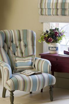 New for 2013 The Annie Sloan Fabric Collection™  Monaco Ticking on the chair and the Roman blind with Burgundy on the side table - flowers by Claire Chalkley, Les Couronnes Sauvages, France