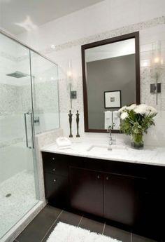 Dark cabinets, marble countertop, grey tiles