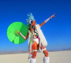 Woman carrying a parasol at Burning Man