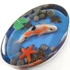 KOI FISH POND - by Veronica Isola - Veronica used polymer clay to create the elements, with Resin Color Film on the bottom reflecting up. Mold, Brilliant Resin and Color Films at little-windows.com