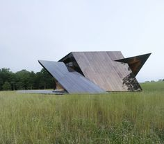 Twisted reflective house with angled walls and ceilings