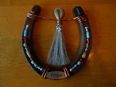 Hey, I found this really awesome Etsy listing at http://www.etsy.com/listing/168852684/custom-horseshoe-with-mane-or-tail-hair