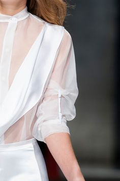 Sleeve Detail - sheer white blouse with white crocodile clip feature for a loosely gathered effect; fashion details // Christopher Kane SS14