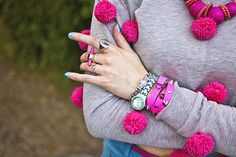 Jewellery detail on ASOS pompom sweatshirt: AnnaLou of London leather wrap bracelet and Guess watch with me & zena ring by Shiny Thoughts in The Silver Stilettos