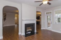 Sunroom with double-sided fireplace in the Clark Craftsman KS
