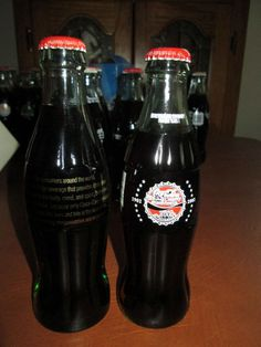 """Coca-Cola bottle 8oz set of 2 *RARE*RARE*RARE* Coca-Cola Company """"Inspirational Bottle"""" """"For consumer around ..."""" in gold lettering Bottle embossed 6 fl ozs CCE-0322 2002 1902-2002 Coca-Cola Bottling Company of Mid-America 100th Anniversary Refreshing our Community for 100 Years! 2001-2386"""