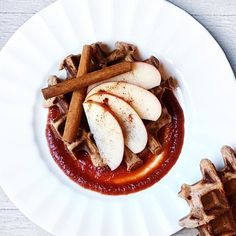 """Happy Waffle Sunday! These wonderful crispy & chewy vegan waffles are made with organic whole wheat pastry flour, unsweetened vanilla soy milk, applesauce, date syrup, flaxseed, apple cider vinegar, cinnamon, baking powder, and salt. Continuing with the apple theme, I whipped up an applesauce, date syrup, cinnamon and cloves sauce, and topped it all off  with some cinnamon sprinkled apple slices. You know the saying """"an apple a day..."""", I got that down today!"""