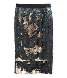 Knee-length skirt in sequined jersey with an elasticized waist and slits at sides. Lined.