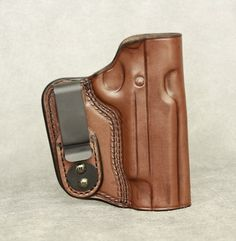 Inside the Waistband Leather Holster for full size 1911 (5 inch barrel). Holster comes in black or brown and has ambidextrous capability (left or right hand draw). The clip can be removed and placed on the other side of the holster for left hand draw or small of back carry. $54.99 #holster #gunholster #concealedcarry #IWB #1911 Gun Holster, Leather Holster, Holsters, Threaded Barrel, Hand Molding, Sig Sauer, Concealed Carry, Leather Craft, How To Draw Hands