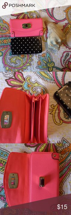 Two Wallet Bundle Slightly used. Slight scuffs on pink wallet (pictured.). Light indents inside black wallet (pictured) and slight white thin scratches on outside. Good condition otherwise. Bags Wallets