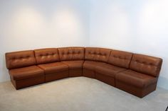 Grand Sectional Lounge Sofa in Cognac Leather | From a unique collection of antique and modern sectional sofas at https://www.1stdibs.com/furniture/seating/sectional-sofas/