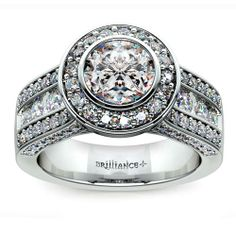 Spring is fast approaching, and there's nothing more apt than hitting the next level in love together as the new season rolls in. Pop the question with the stunning sparkle of the three-sided Halo Bezel Diamond Engagement Ring in durable Platinum, featuring a Round-cut diamond center! http://www.brilliance.com/engagement-rings/halo-bezel-diamond-ring-platinum
