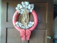 After seeing all the Flip-Flop Wreaths on Pinterest, I wanted to make one:) I used a Dollar Tree pool noodle as the form-bought flip-flops-thumb tacks-raffia-and two bunches of flowers:) total cost...6 bucks;) Fun Inexspensive Project:)