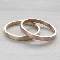 Hers and Hers wedding band set. Two bespoke recycled eco-friendly solid yellow gold, rose gold, or white gold wedding bands. These bands are flat and modern, measuring wide by high with a matte or shiny finish. --The Details-- Thin Gold Rings, Dainty Gold Rings, Wedding Rings Sets His And Hers, Wedding Band Sets, Bridesmaid Jewelry Sets, Wedding Jewelry, Wabi Sabi, Lesbian Wedding Rings, Yellow Bridesmaids