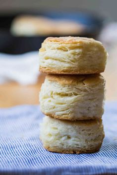 Flaky buttermilk biscuits baked in a cast iron skillet.