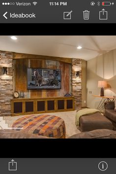Modify this concept using wood and brick.  Add sconces on far right and left.  Add rope light inside wood arch above tv.  Could be amazing.