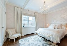 Can we talk about Kimberly Guilfoyle's former apartment? Decorated in soft shades like creams and blues, the prewar pad was simply pretty. The bedroom featured custom built-ins, beamed ceilings, and ample closet space. The combination of Lucite and crystal details with white bedding and furniture made the room feel airy and feminine. Source: Prudential Douglas Elliman