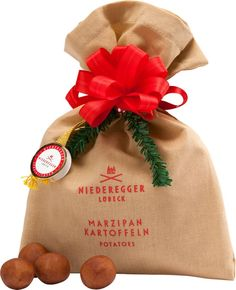 Niederegger Marzipan Potatoes: According to German holiday folklore, instead of receiving coal in their stockings, the girls and boys on St. Nick's naughty list found potatoes under the tree in place of the presents they had asked for. As a nod to this German tradition, the folks at Niederegger took the liberty to have a little fun and created potato-shaped marzipan treats dusted with cinnamon, so they look like the real thing.