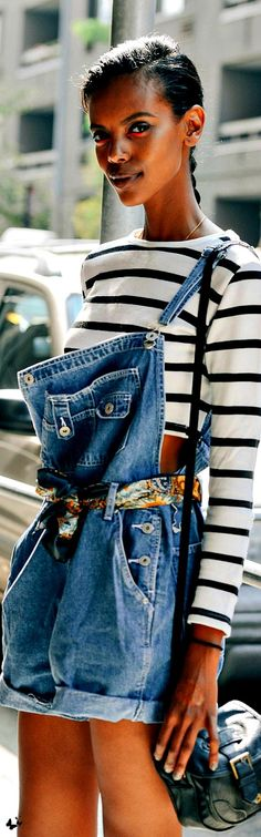Very cute oversized overall shorts tied up and worn with striped tee