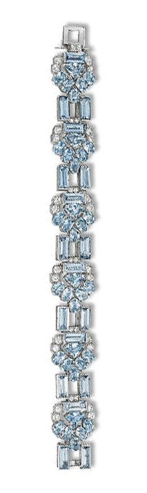 AN ART DECO AQUAMARINE AND DIAMOND BRACELET, BY CARTIER   The six arrow-shaped panels each set with six oval-shaped aquamarines to the trapeze-shaped aquamarine centre and circular-cut diamond links to the baguette-cut aquamarine two-stone spacers, circa 1935, 18.2 cm long, in original fitted red leather Cartier case  Signed Cartier, London